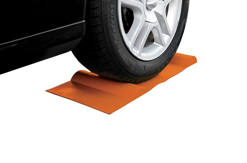 Wheel Chocks And Parking Stops To Delimit And Signal Garage Spaces